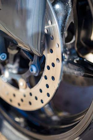Closeup of Modern Motorcycle Front Brake Disks. Vertical Image