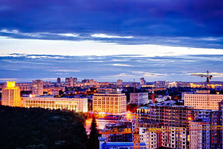 Minsk City at NIght with Construction Site and Building Cranes in Frame at Dusk. Horizontal Image Orientation Imagens
