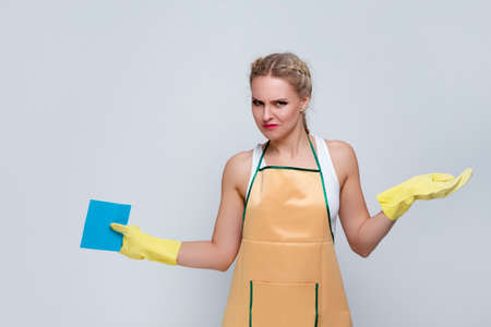 Household Ideas. Portrait of Frustrated Caucasian Female With Rubber Sponge Posing With Lifted Hands Against White. Horizontal Image