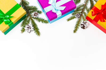Lots of Colorful Gift Boxes with Cones and Fir Tree Branches Placed Together On White Top View.Horizontal Image Orientation