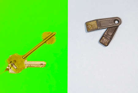 Home Concepts. Bunch of Traditional Metal House Keys Against Pair of Electronic Chip Keys Together Over Colorful Background.Horizontal Image Orientation