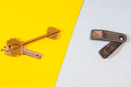 Bunch of Traditional Metal House Keys Against Pair of Electronic Chip Keys Together Over Colorful Background. Horizontal Image Orientation