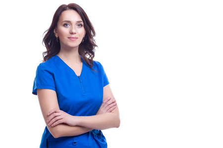 Positive Professional Female GP Doctor Posing in Blue Doctor's Smock On White Background. Horizontal Composition