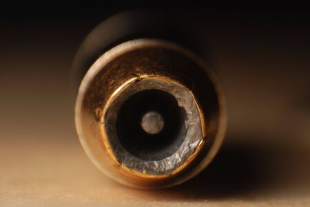 projectile: Closeup of the front of a hollow point bullet