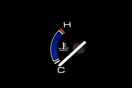 Temperature gauge of a vehicle.  Isolated on a black background with planty of copyspace.