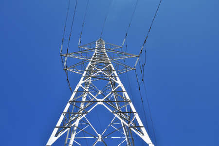 cabling: High power tower pole against blue sky