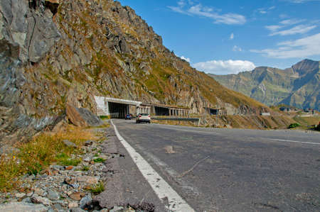 altitude: Cars on the mountain road with tunnels at high altitude