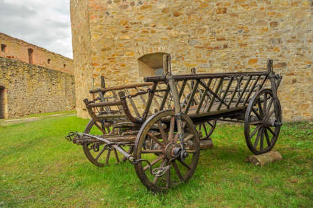 spoked: Old cart inside the medieval castle