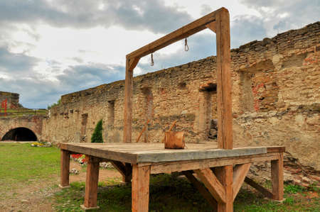 gallows: Wood gallows around medieval building Stock Photo