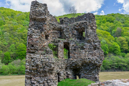 Medieval broken tower. The custom-house on Olt river in Carpathian mountains.