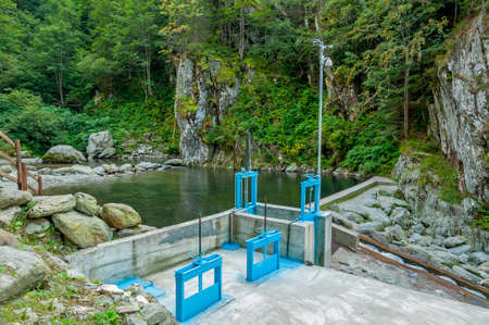 hydro electric: Micro hydro electric dam in Carpathian Mountains Stock Photo