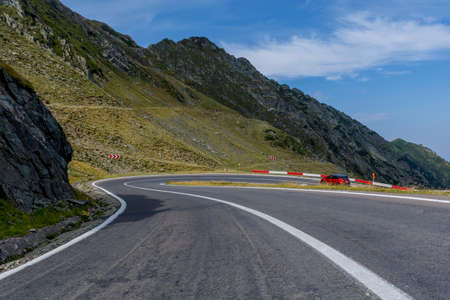 balea: Car traffic on Transfagarasan mountain winding road, from Carpathian mountains in Romania. Stock Photo