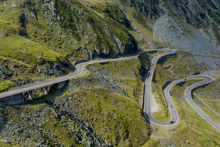 balea: Winding mountain road with dangerous curves in Carpathian mountains. Transfagarasan road in Romania.