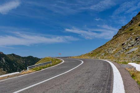 Winding mountain road with dangerous curves in Carpathian mountains. Transfagarasan road in Romania.
