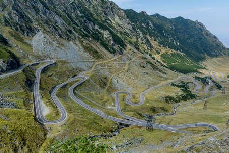 Transfagarasan - High altitude winding road in Carpathians mountains panorama. Aerial view.