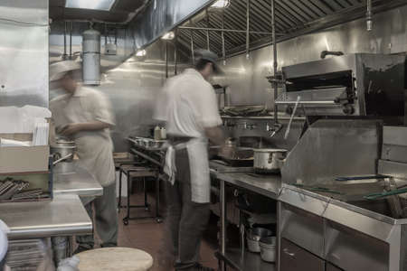 dinne: two asian chefs cooking in ketchen