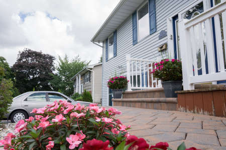 drive way: a house with a car parked on the drive way Stock Photo