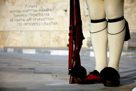 The legs of a presidential guard (tsiolias) in Athens (Greece)