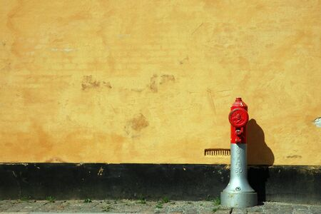 water hydrant in front of a building Stock Photo
