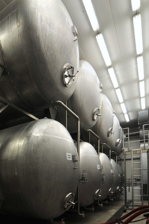 Stainless steel reservoirs in a brewery