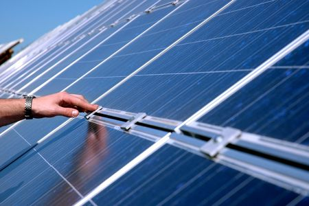 compile: Touching a solar panel Stock Photo