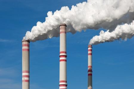 Chimney smoke with blue sky