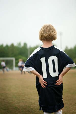 Blonde girl playing soccer  football