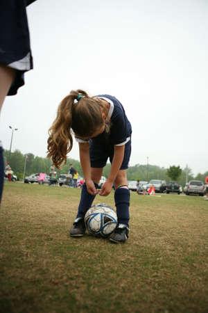 Girls soccer or football player bending over Stock Photo