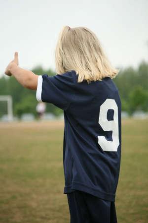 Girl soccer player or footballer giving thumbs up