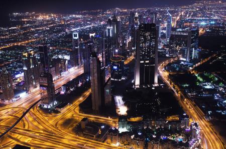 sheik: downtown dubai city lights sheik zayed road Editorial
