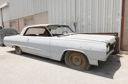 1964 Chevrolet Impala car left in ruin needing restoration Editorial