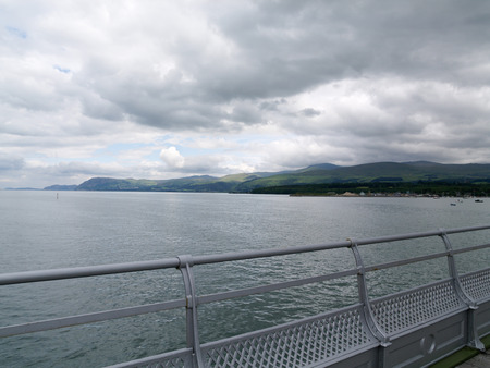 garth: over cast cloudy day over the menai strait bangor pier north wales