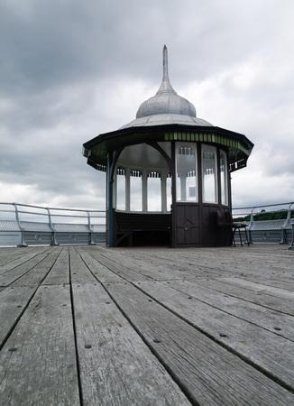garth: garth pier kiosk in bangor north wales on an overcast day