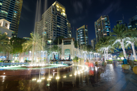 water feature: dubai marina water feature lights lit up at night with famous landmark buildings Editorial