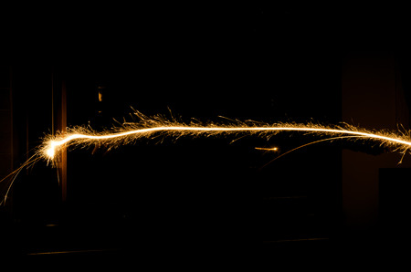 light trail: sparkler light trail in dark environment using slow shutter speed