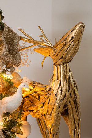 animal angelic: golden christmas xmas decorations with reindeer under christmas tree