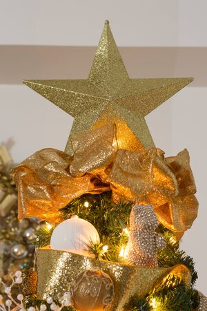 animal angelic: golden christmas xmas decorations with star on top of tree