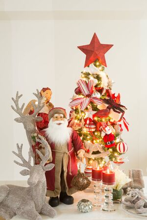 animal angelic: golden christmas xmas decorations with father xmas and christmas tree
