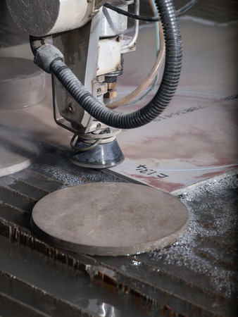 cutting through: water pressure cutting through stainless steel materials
