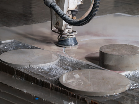water pressure cutting through stainless steel materials