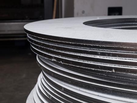 steel plate: stainless steel cut metal rings Stock Photo