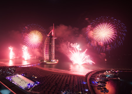 burj al arab new years eve fireworks with reflection on the sea