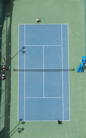 ariel: ariel view of a tennis court birds eye view