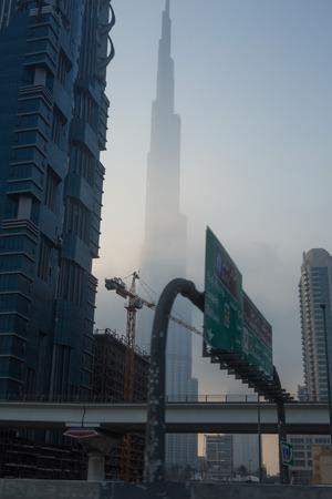 sheik: burn khalifa covered in fog near sheik bayed road Editorial