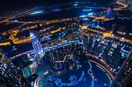 sheik: downtown dubai futuristic city neon lights and sheik zayed road shot from the worlds tallest tower burj khalifa Stock Photo