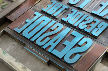 monotype: typeset letter blocks with blue paint