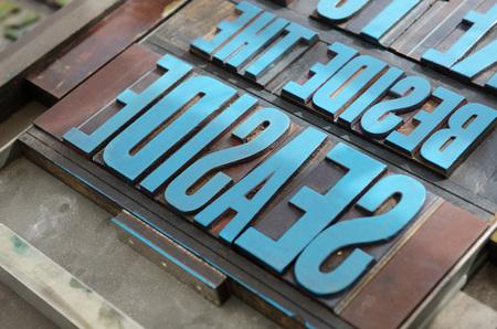 typeset: typeset letter blocks with blue paint