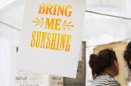 screened: vintage wise quotes screen printed and hanging out to dry Stock Photo
