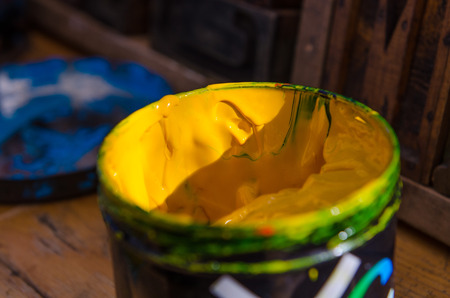yellow acrylic paint pot preparing for mono print and screen printing