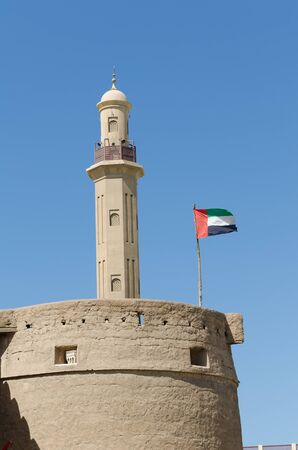 bur dubai: bur dubai mosque and old history museum with the use flag